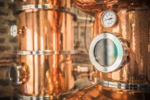 Photo showing the shiny gin still at Beinn an Tuirc distillery